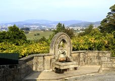 Roriz – Water Fountain. Wider view of the water fountain located at the churchyard of the Church of St Peter in Roriz, Portugal Royalty Free Stock Images