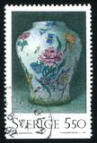 Rorstrand Vase. RUSSIA KALININGRAD, 29 SEPTEMBER 2013: stamp printed by Sweden, shows Rorstrand Vase, by Erik Wahlberg, circa 1992 stock photos