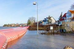 Rosa Abfluss gegen den Sturm Urd in Frederikssund, Dänemark Lizenzfreie Stockfotos