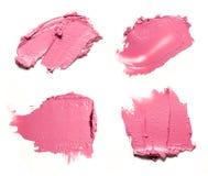 Rosa Abstrichfarbe von kosmetischen Produkten Stockbilder