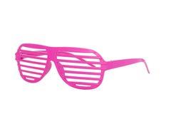 Rosa achtziger Jahre kerben die Gläser, die auf weißem Hintergrund lokalisiert werden Stockbild