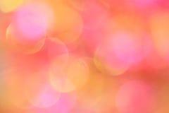 Rosa bakgrund: Foto för materiel för suddighet för moderdag Arkivbild