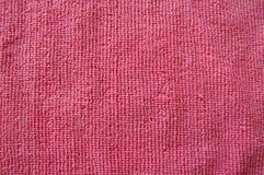 Rosa bakgrund, mjuk microfibertygtextur Arkivbild