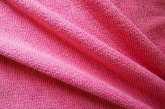 Rosa bakgrund, mjukt microfibertexturtyg viker Arkivbild