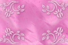 Rosa bakgrundssuddighet med blommor i hörnen Arkivfoto