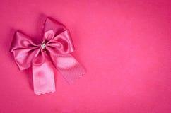 Rosa band på rosa bakgrund Fotografering för Bildbyråer
