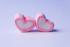 Rosa begrepp för valentin för marshmallowhjärtaform Arkivbild