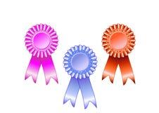 Rosa-, Blaue und Rotepreisrosette Lizenzfreie Stockfotografie