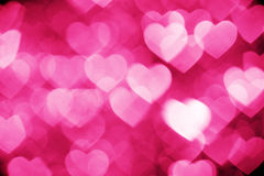 Rosa bokeh von Herzen Stockfotos