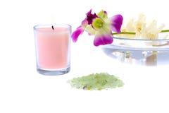 rosa brunnsorttema för stearinljus Arkivfoto