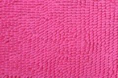 Rosa dörrmatta för bakgrundstextur Royaltyfri Bild