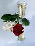 Rosa e champagne Fotografie Stock