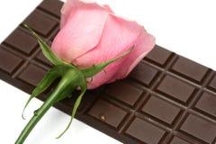 Rosa e chocolate Fotografia de Stock