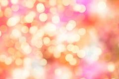Rosa e luci del fondo illuminate giallo Immagini Stock