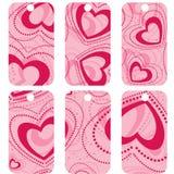 Rosa färg märker med hjärtor Arkivfoton