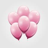 Rosa färgballong på grå bakgrund Arkivbild