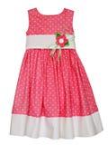 Rosa färger behandla som ett barn klänningen Arkivfoto