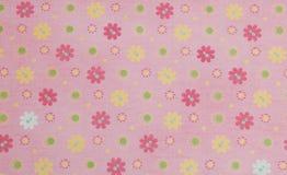Rosa färger blommar bakgrund, scrapbookingpinkbakgrund med kulöra blommor som scrapbooking papperspapper Fotografering för Bildbyråer