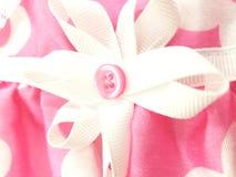 Rosa färger och pilbåge royaltyfri fotografi