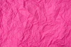 Rosa färger skrynklade pappers- textur som bakgrund arkivfoto