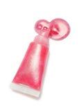 Rosa Farbe des Lipglosses vom Rohr auf weißem Hintergrund lizenzfreie stockbilder