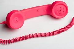 Rosa färgtelefon och kabel Royaltyfri Fotografi