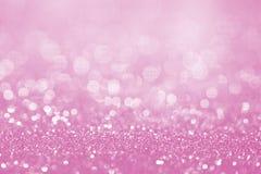 Rosa Funkelnoberfläche mit rosa hellem bokeh - es kann für benutzt werden lizenzfreies stockbild