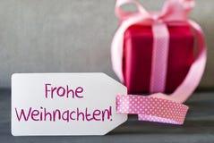 Rosa Geschenk, Aufkleber, Frohe Weihnachten bedeutet frohe Weihnachten Lizenzfreies Stockfoto