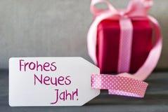 Rosa Geschenk, Aufkleber, Frohes Neues Jahr bedeutet guten Rutsch ins Neue Jahr Stockfotos