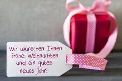 Rosa Geschenk, Aufkleber, Gutes Neues Jahr bedeutet guten Rutsch ins Neue Jahr Stockbilder