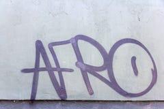 Rosa Graffiti auf einer Steinwand lizenzfreies stockfoto