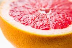 Rosa grapefrukt för frukt i snittet En vitaminprodukt äta som är sunt arkivfoto