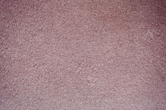 Rosa gropig stuckaturväggbakgrund Royaltyfri Bild