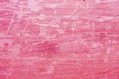 Rosa grungebakgrund med skrapor Arkivfoton