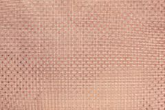 Rosa guld- bakgrund från papper för metallfolie med en stjärnamodell arkivbilder