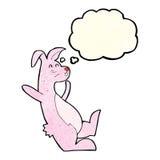 rosa Häschen der Karikatur mit Gedankenblase Stockbild