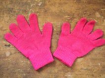 Rosa Handschuhe lizenzfreie stockfotografie