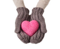 Rosa Herz in den Wollhandschuhen Stockbild