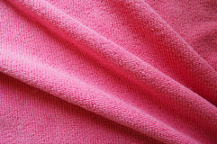 Rosa Hintergrund, weiches microfiber Beschaffenheitsgewebe faltet sich stockfotografie