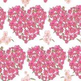 Rosa hjärta av pansies på en vit bakgrund Seamless bakgrund Arkivfoto