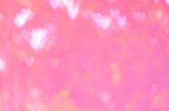 Rosa hjärtabokeh för abstrakt bakgrund Royaltyfria Foton