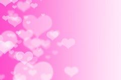 Rosa hjärtabokeh som bakgrund Arkivfoto