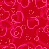 Rosa hjärtor på en röd bakgrund Royaltyfria Foton