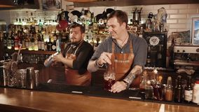 Rosa Khutor - February 2018: Bar. Rosa Khutor - February 2018: Bar Two friends working in a bar mixing cocktails. Happy faces, smiling and having fun. Process stock video