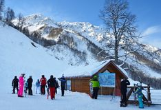 Rosa Khutor, Sochi, Russia, January, 26, 2018. Snowboarders at the ski resort `Rosa Khutor near ` map` of slopes. Rosa Khutor, Sochi, Russia. Snowboarders at the royalty free stock image