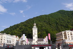 Rosa Khutor Town hall with Clock tower. Sochi, Russia Stock Image