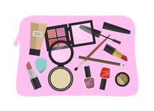 Rosa kosmetisk påse med färgrika kosmetiska produkter för plan design - Arkivbild
