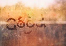 Rosa krople na szkle inskrypcja na okno - Dobrym zdjęcia stock