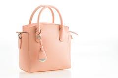 Rosa kvinnahandväska för härlig elegans och för lyxigt mode royaltyfria bilder