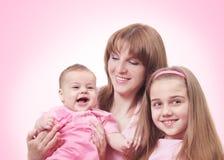 rosa kvinnor för barn Arkivbilder